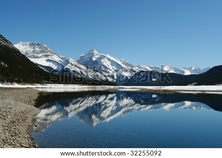 Winter view of canadian rockies and lake in kananaskis, Alberta, Canada - stock photo