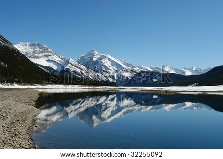 Winter view of canadian rockies and lake in kananaskis, Alberta, Canada - stock photo