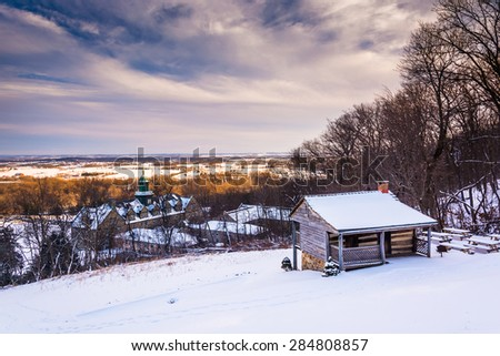 Winter view of John Hughes Cabin and Mount St. Marys University from the Grotto of Lourdes in Emmitsburg, Maryland. - stock photo
