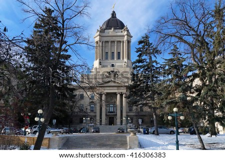 Winter view on Manitoba Legislature building. Winnipeg, Manitoba, Canada. This neoclassical building with the Golden Boy statue on its cupola was designed and built by Frank Worthington Simon in 1920. - stock photo