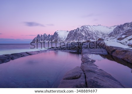 Winter view to Steinfjord on Senja island in the sunset - Troms county, Norway (long exposure) - stock photo