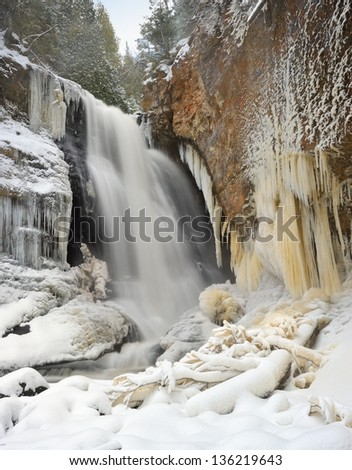 Winter waterfall at Miners Falls Pictured Rocks National Lakeshore - stock photo