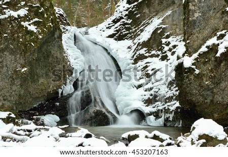 Winter waterfall landscape with frozen water detail - stock photo