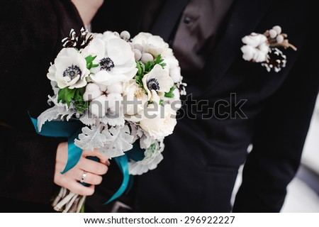 winter wedding with beautiful white bouquet - stock photo