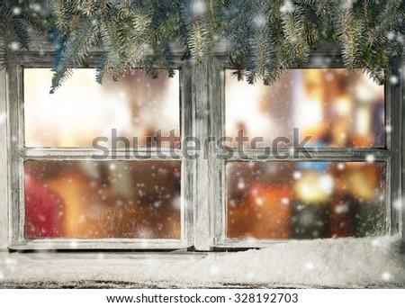 Winter window view into old cottage interior - stock photo