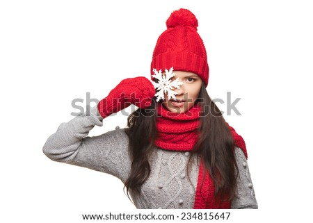 Winter woman in red hat, scarf, mittens with snowflake over white background - stock photo