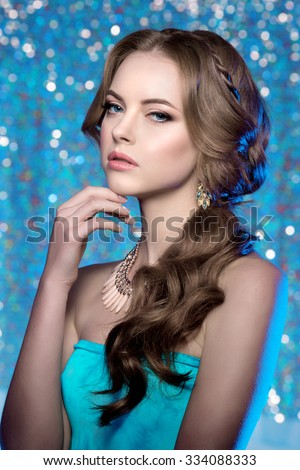 Winter woman model gorgeous beauty makeup stylish hairstyle Young girl background bokeh Lady make up Mascara long lashes lipstick lips eye shadow shiny hair manicure nail polish Products Treatment - stock photo