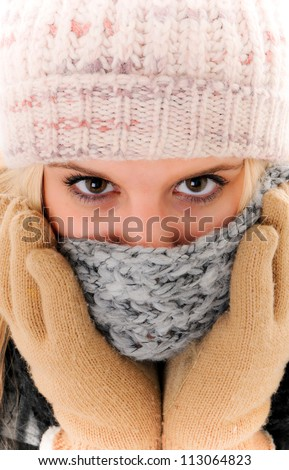 Winter Woman with Beautiful eyes wearing a Scarf and Mittens covering her mouth and nose - stock photo