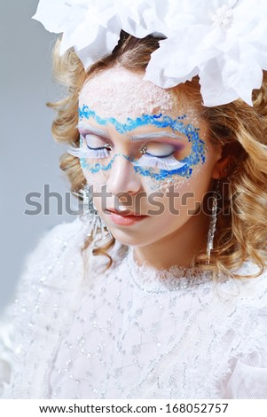 Winter woman with ice and snow style makeup false eyelashes - stock photo