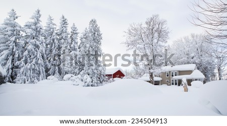 Winter wonderland. Snow covered Western New York landscape. With an old farm house and red barn draped in snow, this image is perfect as a Christmas / Holiday background.  - stock photo