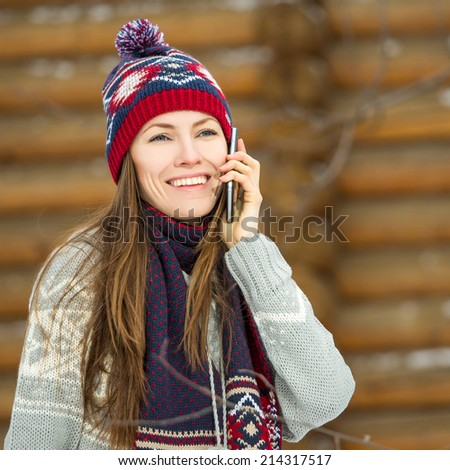 Winter young woman talking on mobile phone. outdoor shot - stock photo