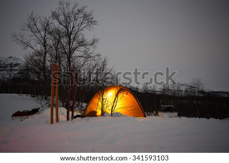 Wintercamping in Northern Sweden - stock photo