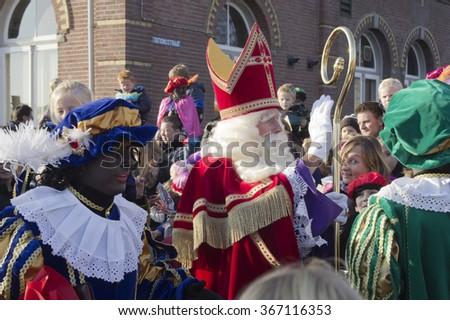 WINTERSWIJK, THE NETHERLANDS - 12 NOVEMBER 2011: Santa Claus arrives in the Netherlands  on 12 November  2011 in Winterswijk, Holland. - stock photo