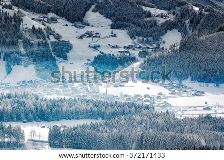 Wintery village in alpine valley, Tyrol, Austria - stock photo