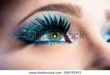 Wintry Creative Eye Makeup. False Long Blue Eyelashes Closeup   - stock photo