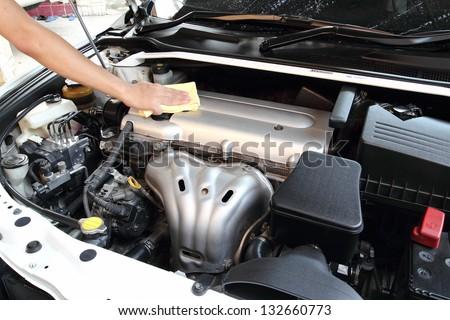 Wipe the car engine - stock photo