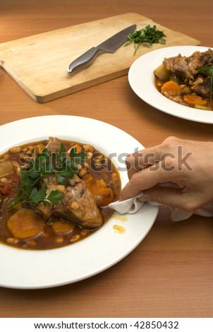 wiping a plate clean - stock photo