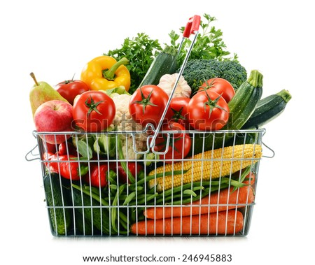 Wire shopping basket with groceries isolated on white background - stock photo