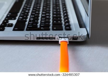 wire usb orange - stock photo
