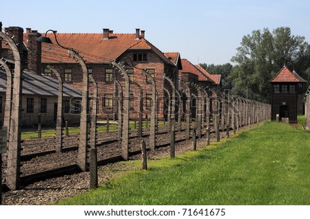 wired fences of concentration camp Auschwitz in Oswiecim, Poland - stock photo