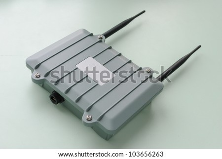 Wireless access point for outdoor installation with two installed antennas. - stock photo