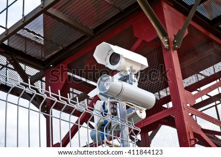 Wireless color security camera with night vision on the fence - stock photo