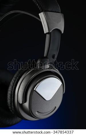 Wireless headphones isolated on black background - stock photo