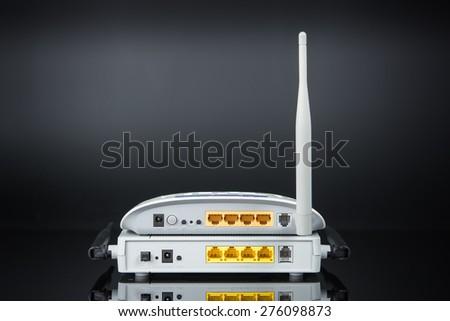 Wireless modem router network hub on black background - stock photo
