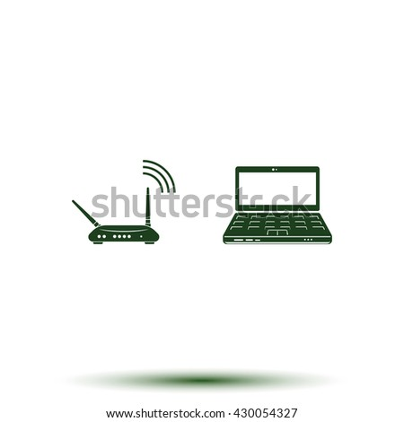 Wireless router connected to laptop. - stock photo