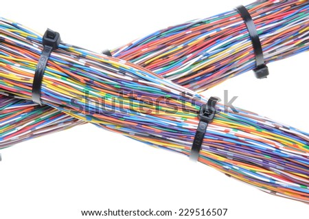 Wires with cable ties isolated on white background - stock photo
