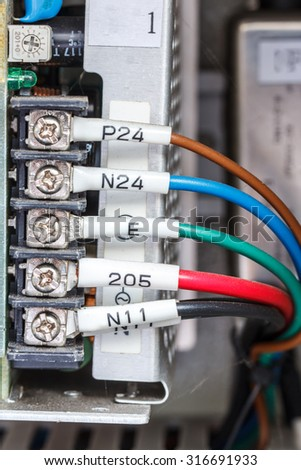 Wiring -- Program control panel with wires in industry - stock photo