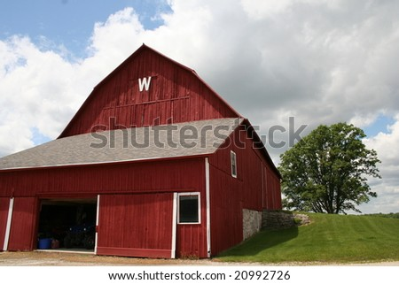 wisconsin red barn with clouds - stock photo
