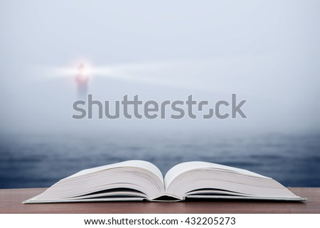 Wisdom concept - open book over sea and lighthouse background - stock photo