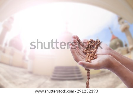 Wish empty hand of man blurred background Mosque - stock photo