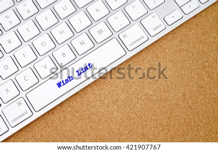 Wish List on computer keyboard background with copyspace area.  - stock photo
