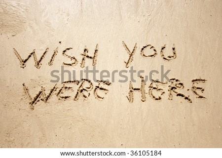 Wish you were here handwritten in sand for natural, symbol,tourism or conceptual designs - stock photo