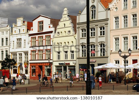 WISMAR, GERMANY - AUGUST 13: People going sightseeing and shopping on August 13, 2012 in Wismar. Wismar is a famous hanseatic city in the north of Germany - stock photo