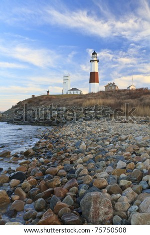Wispy clouds at sunset behind the Montauk Lighthouse at the Eastern end of Long Island, New York - stock photo