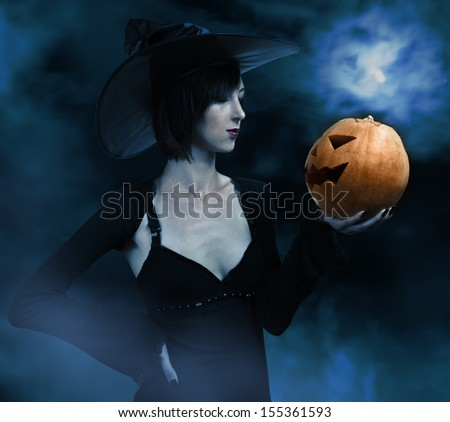 Witch in the Night Halloween - stock photo