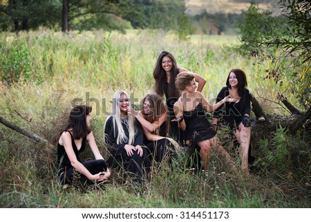 Witches at the Sabbath talking and laughing - stock photo