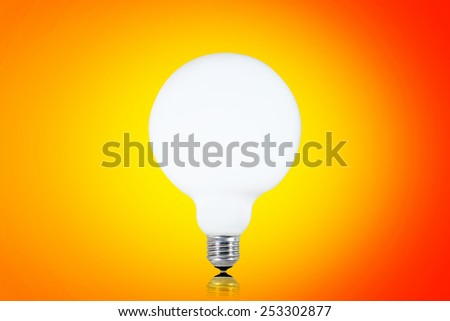 Wite bulb isolated on orange. - stock photo