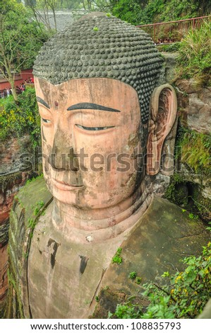 With a construction completed in 803, carved in the mountain facing the river, and with a height of 71 m, the Leshan Giant Buddha is the world's tallest, China. - stock photo