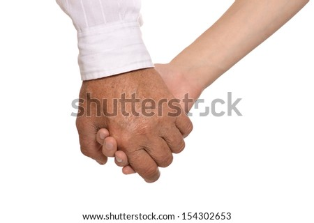 With arms crossed against a light background - stock photo