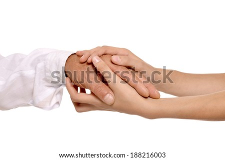 With arms holding against a light background - stock photo