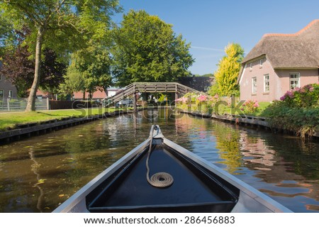 With boat in village Giethoorn in Holland  - stock photo