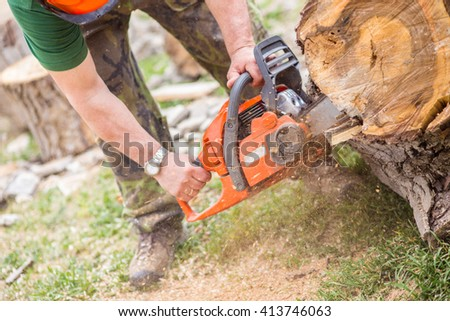 With chainsaw - stock photo