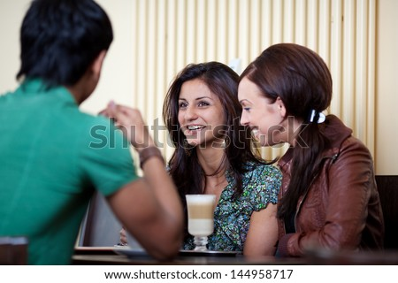 With friends at a cafe and having a good time - stock photo