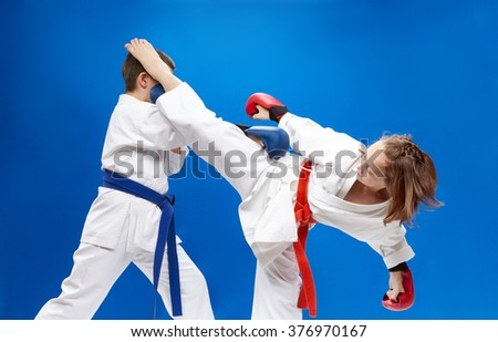 With overlays on the hands of the athletes are training blows karate - stock photo