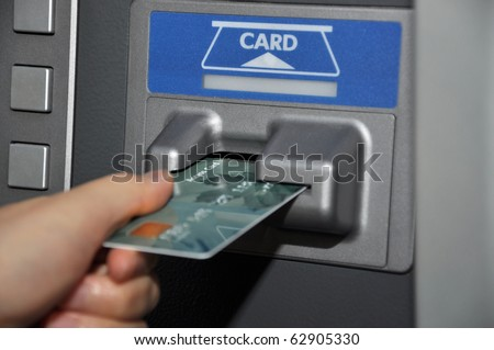 Withdraw money from ATM machine - stock photo
