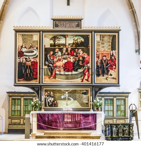 WITTENBERG, GERMANY - MAR 25, 2016:  famous altar from Lucas Cranach in the civic church in Wittenberg, Germany. The first mention of the Pfarrkirche St.-Marien dates to 1187. - stock photo